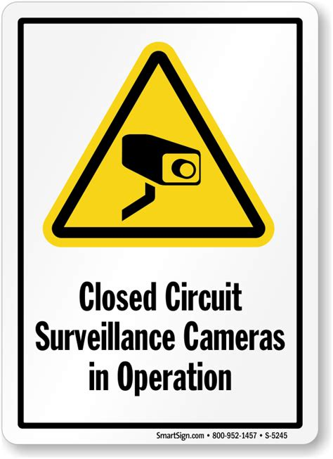 closed circuit surveillance cameras in operation signs