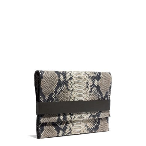 couch clutch coach bleecker clutch in python embossed leather lyst