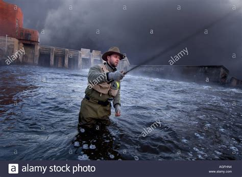 fishing boat caught in storm man fishing in a storm stock photo royalty free image
