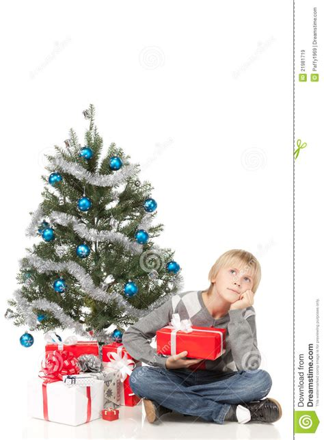 boy sitting near christmas tree royalty free stock images