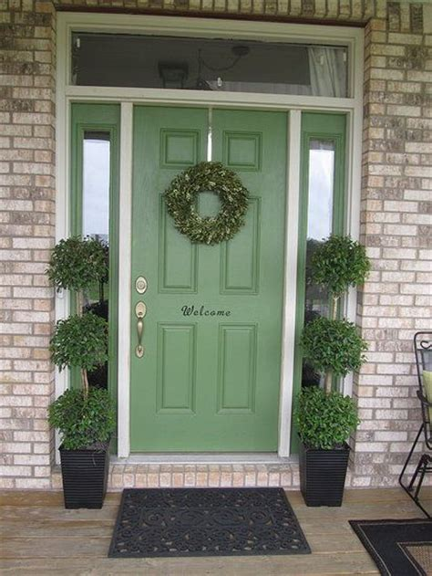 pretty green front door to paint the sidelights or not hmm paint colors