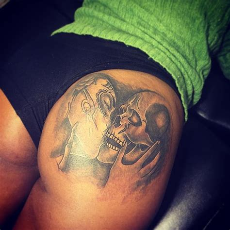 skull kissing tattoo buttock tattoos