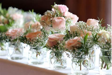 registrar table décor   ceremony table   jam jar flowers
