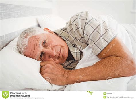 man in bed sick senior man lying on bed stock image image of