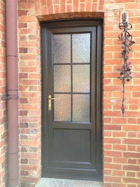 Brown Upvc Front Door Upvc Doors Front Doors Doors Sliding Patio Doors In Surrey