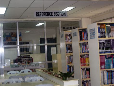 reference section in library holy angel university laus deo semper