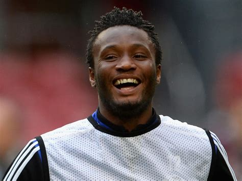 mikel obi poses with his and babies in