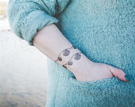 seashell tattoos 15 dashing seashell wrist tattoos