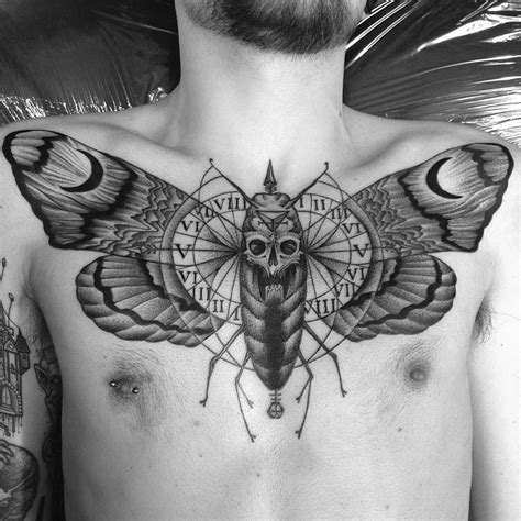 10 tattoo artists paying homage to the death moth scene360