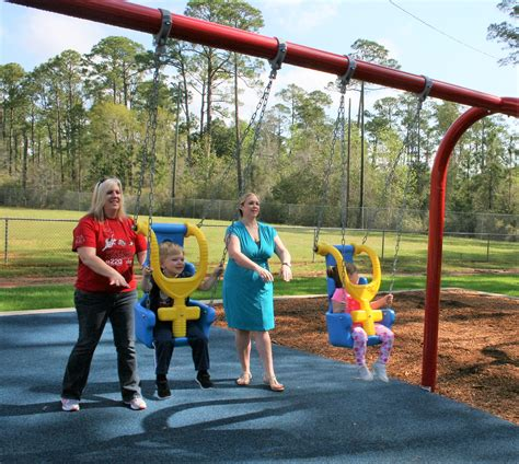 swing ball for kids ribbon cutting for new playground set for april 30 south