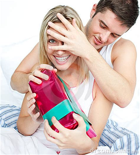 how to surprise your boyfriend in bed boyfriend giving a surprise to her girlfriend royalty free stock photos image 11360088