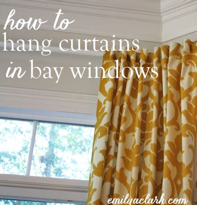 how do you hang curtains in a bay window hanging curtains on angled windows emily a clark