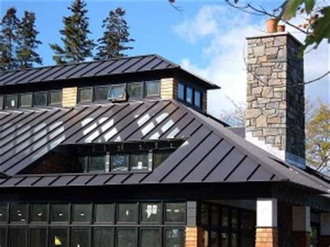 spitzdachhaus kaufen metal vs tile how does metal roofing compare to concrete
