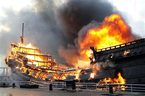 tow boat on fire fire severely damages a replica merchant ship moored at