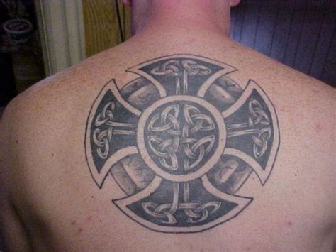 a tattoo of a solar wheel cross made out of celtic knots