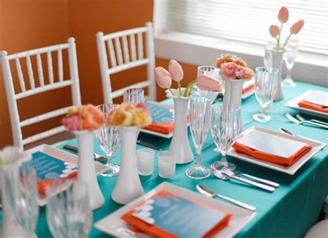 orange and turquoise tablescape turquoise with orange loving this sunny tablescape from somewhere splendid the