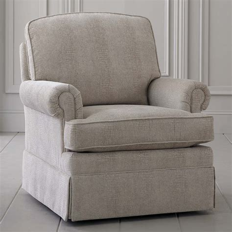 traditional upholstered skirted swivel glider