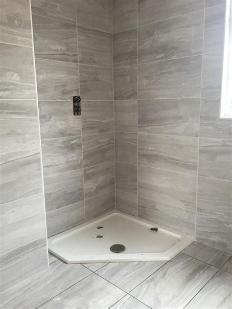 Bathroom Flooring B And Q fossilised wood pebble effect ceramic wall floor