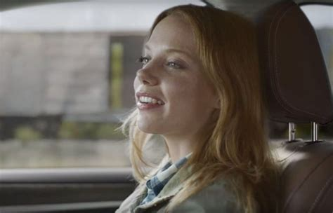 actress in commercial who is the red haired woman riding the train in subaru s
