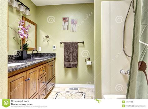 Bright Bathroom In Light Green Tone Wooden Cabinet With Bright Bathroom Light