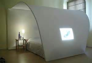 Modern white bedroom furniture design with a unique shape