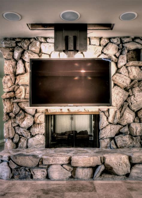 tv in front of fireplace retractable ceiling tv mount motorized ceiling drop down