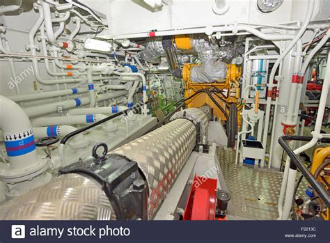 small boat engine room engine room on a cargo boat ship stock photo royalty free