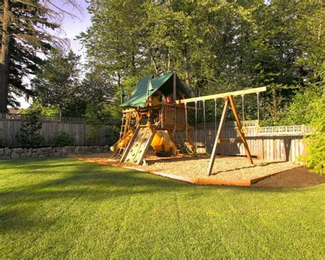 swing set border wood border around swing set fill in with mulch barbie
