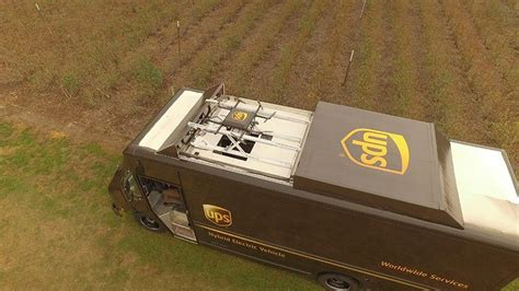 ups delivery drone takes   atop package car