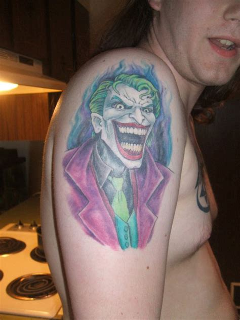 joker smile tattoo 31 captivating joker designs creativefan