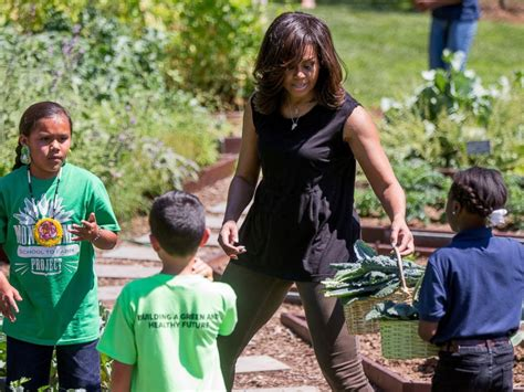 white house for kids first lady michell obama flexes muscles while harvesting