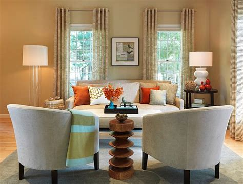 beige and orange living room how to mix patterns appropriately