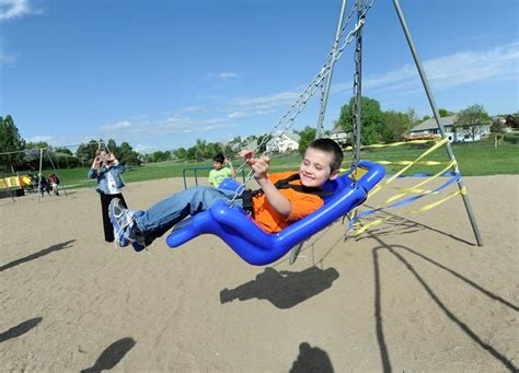 school playground swings students raise money for accessible swings loveland