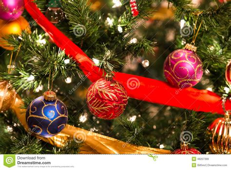 colorful christmas tree ornaments and decorations stock