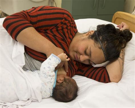 good head in a comfortable bed breastfeeding holds kidshealth