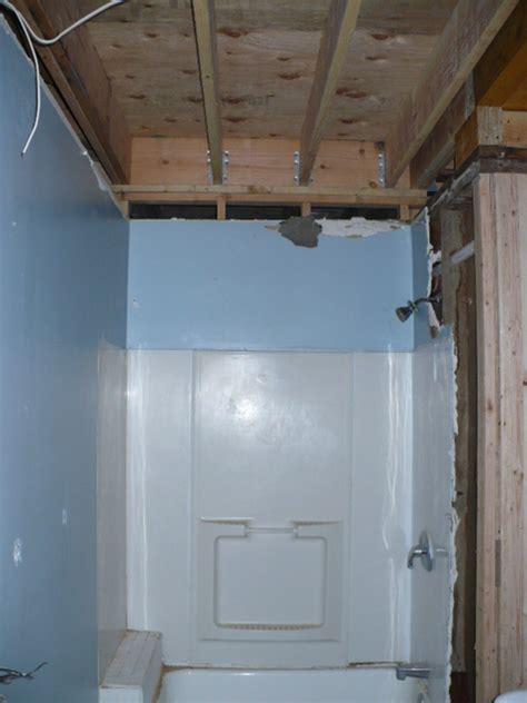 water leaking from second floor bathroom wood floors