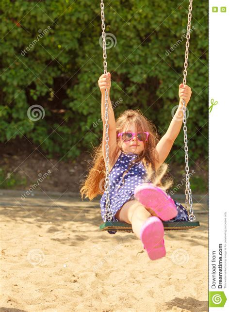 girls swing set girl swinging on swing set stock photo cartoondealer