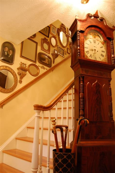 stairway decor decorate staircases with vintage photos mirrors and small wall sconce shelf