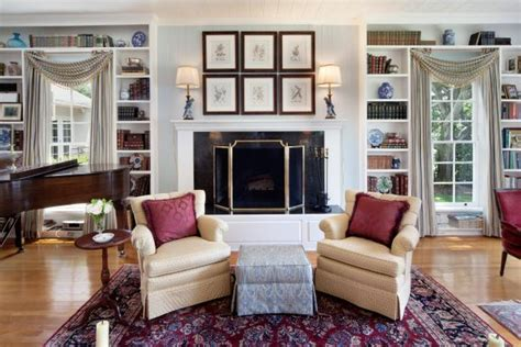 elegant living room features fireplace built  bookcases