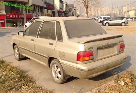 the ultimate car guide kia pride sedan generation 1 1992 2000 spotted in china a dusty kia pride sedan carnewschina com