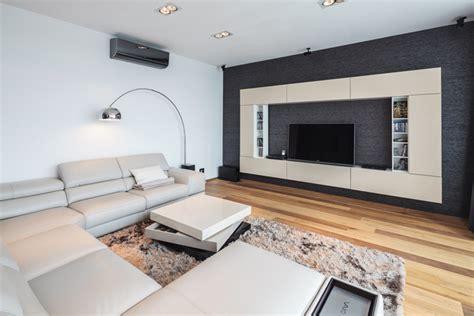 sleek beige living room  brown wood flooring  grey