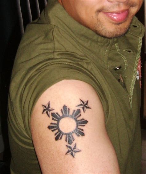 filipino tribal tattoo meanings designs simple on arm busbones