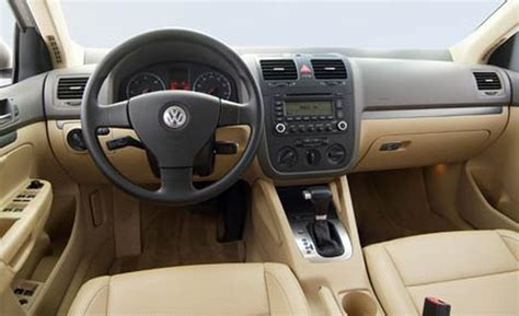 red volkswagen jetta interior car and driver