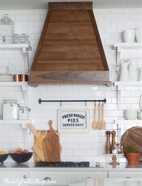 white symmetrical kitchen range with natural wooden white kitchen with wood range hood home kitchen