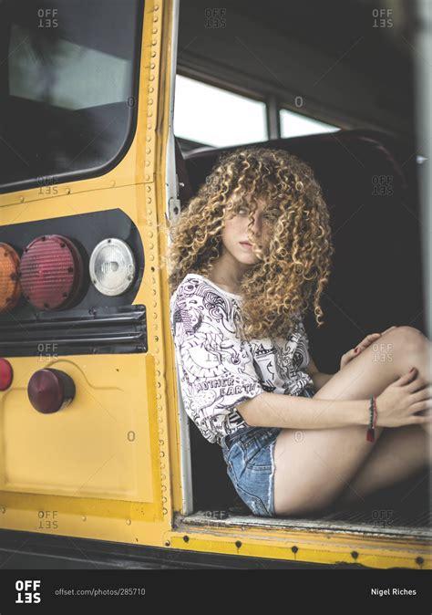 portrait  young woman sitting    door