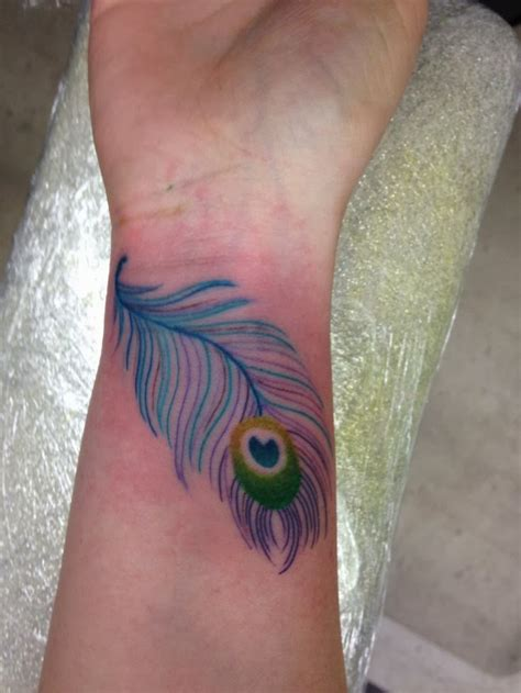 feather tattoo design peacock feather tattoos designs ideas and meaning