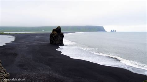 beach with black sand walking reynisfjara black sand beach in iceland the