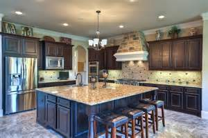 Kitchen 16x14 surrounds a wide 8x8 granite topped center island