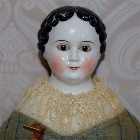 porcelain doll with glasses german glazed porcelain greiner style china doll with