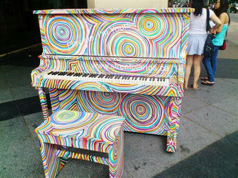 painting you can play artsy outdoor pianos you can play for free wow amazing